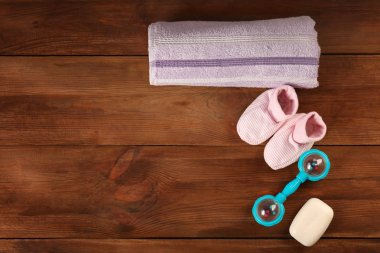 Baby necessities on wooden table