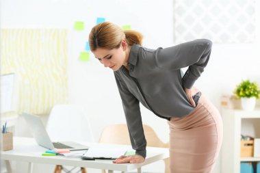 woman suffering from backache