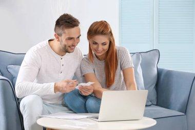 couple calculating taxes