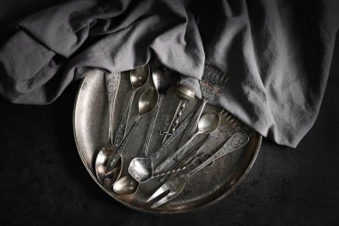 Set of silverware on background
