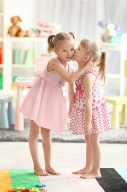 little girl kissing sister