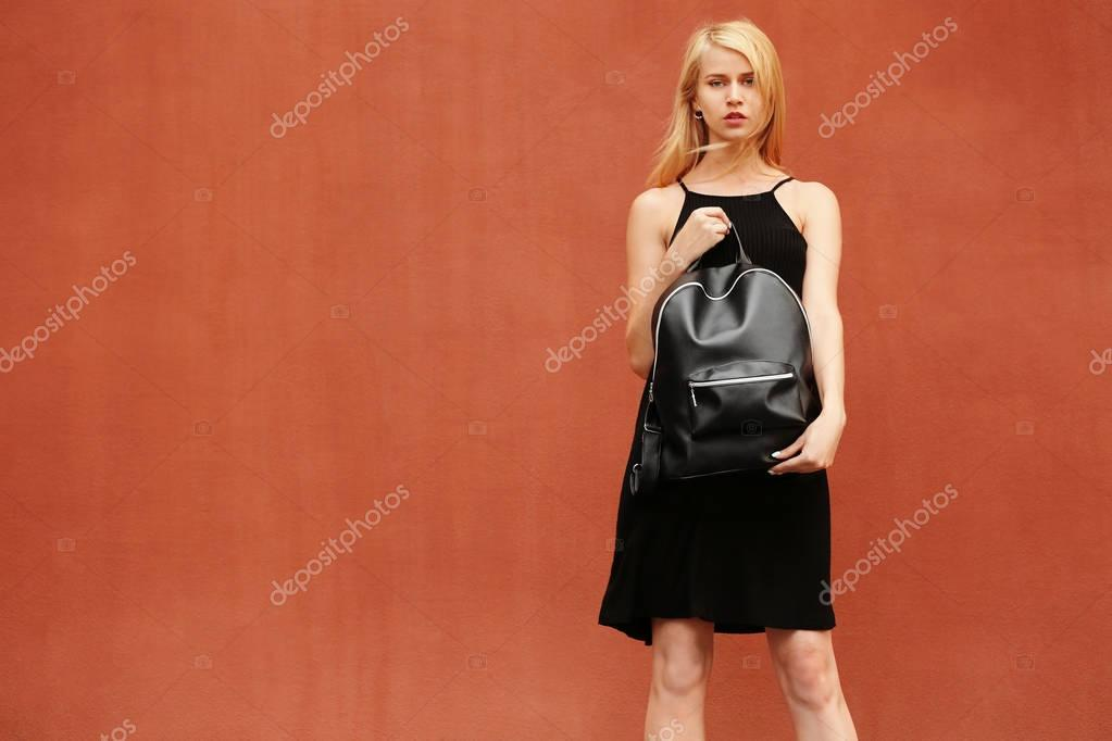 Stylish young woman in black dress