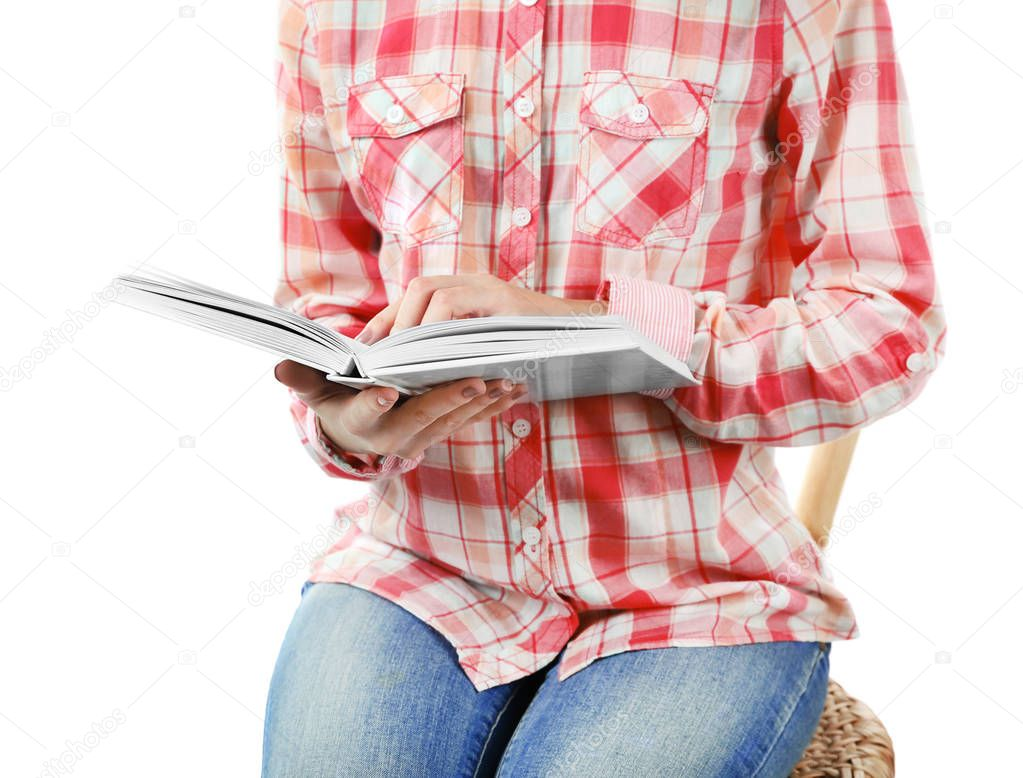 Woman with book sitting on chair on white background