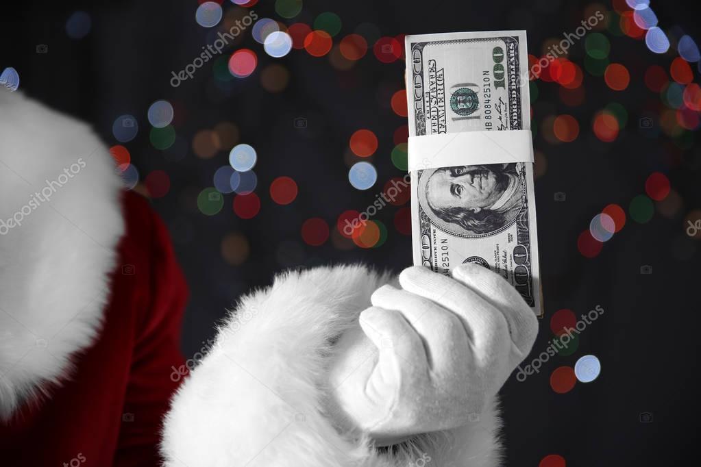 Santa Claus hand holding money