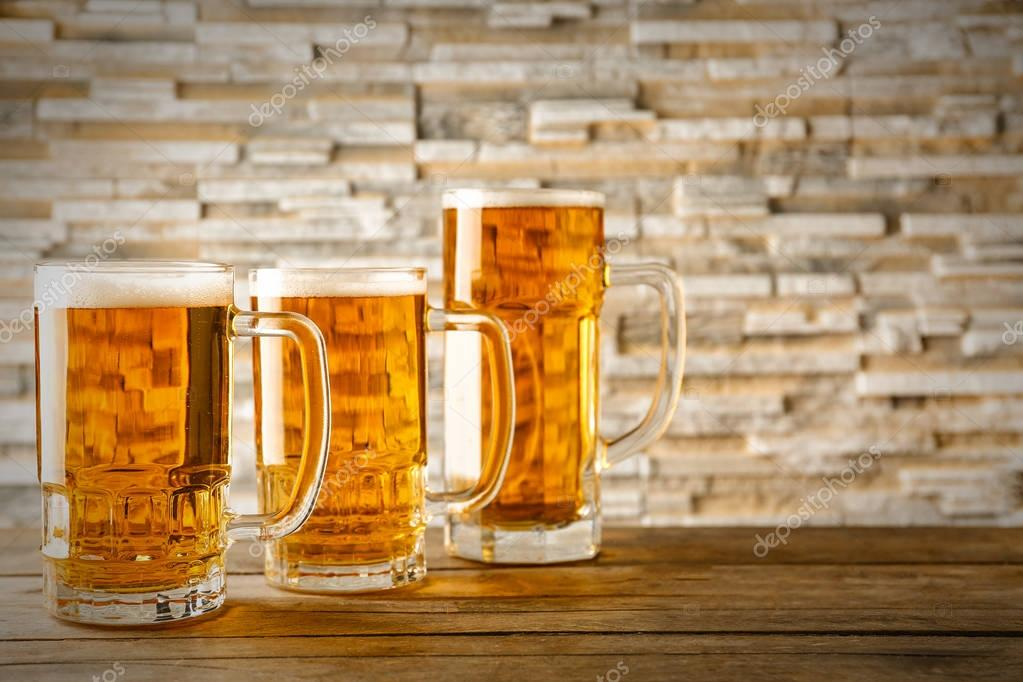 Mugs with cold beer