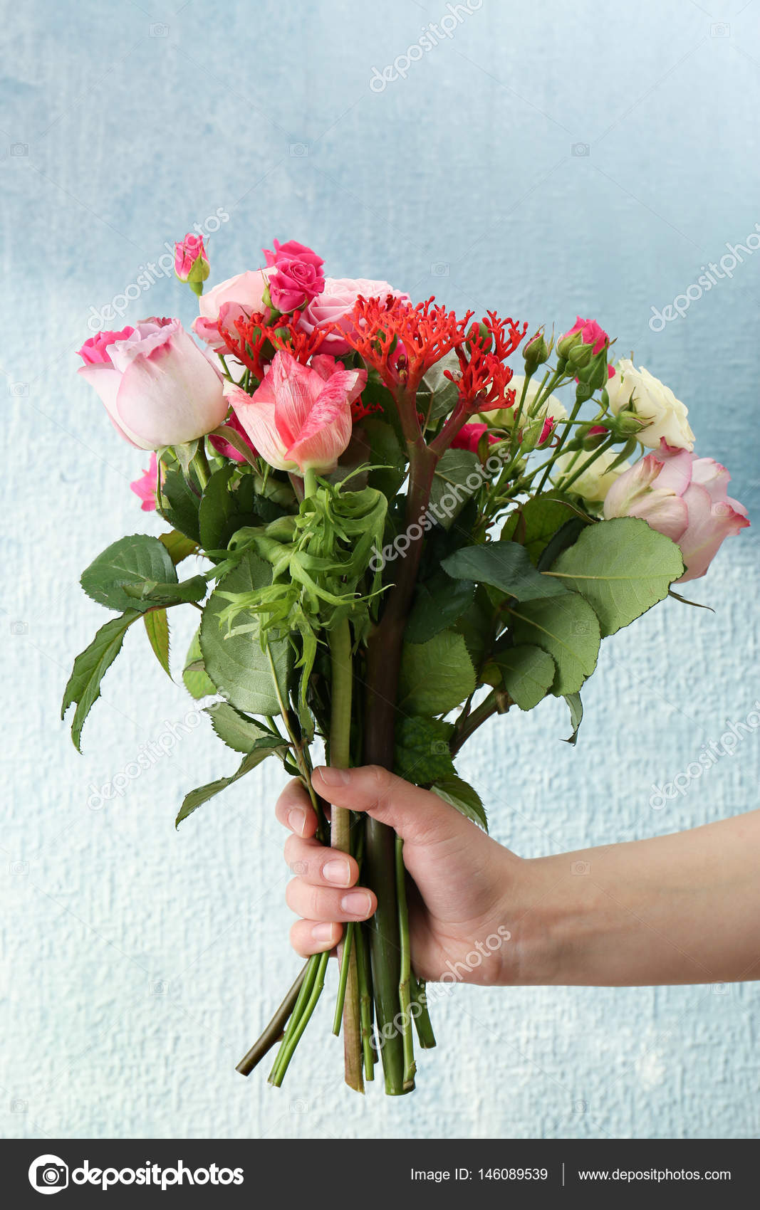 Woman hand holding bouquet of flowers stock photo belchonock woman hand holding bouquet of fresh flowers on light background photo by belchonock izmirmasajfo