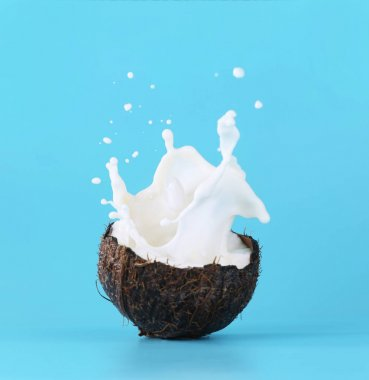 Cracked coconut with splashes of milk