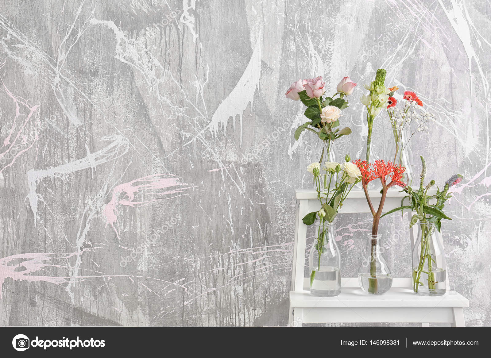Beautiful flowers in glass vases stock photo belchonock 146098381 beautiful flowers in glass vases on step ladder against textured wall background photo by belchonock izmirmasajfo