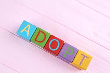 Colorful cubes with word ADOPT