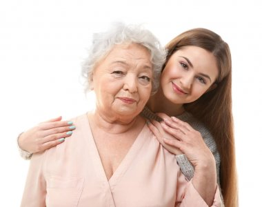 Beautiful girl with grandmother on white background