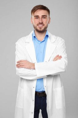 Handsome doctor with crossed hands