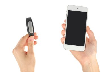 Hands with heart rate monitor and smartphone