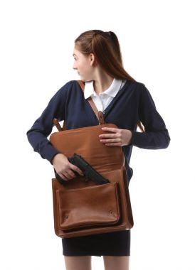 Teenage girl hiding gun in bag on white background stock vector