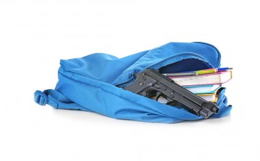 School backpack with books and gun on white background