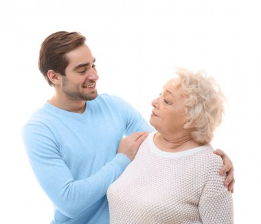 Young man with grandmother on white background