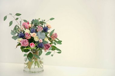 Glass vase with beautiful bouquet