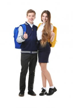 Teenagers with backpacks standing on white background