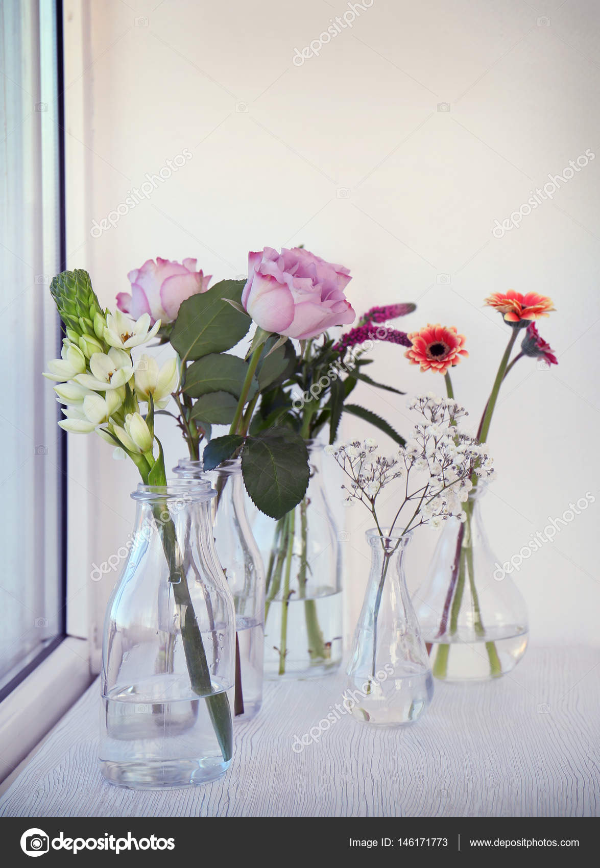 Glass vases with beautiful bouquets of flowers stock photo glass vases with beautiful bouquets of fresh flowers on windowsill photo by belchonock reviewsmspy