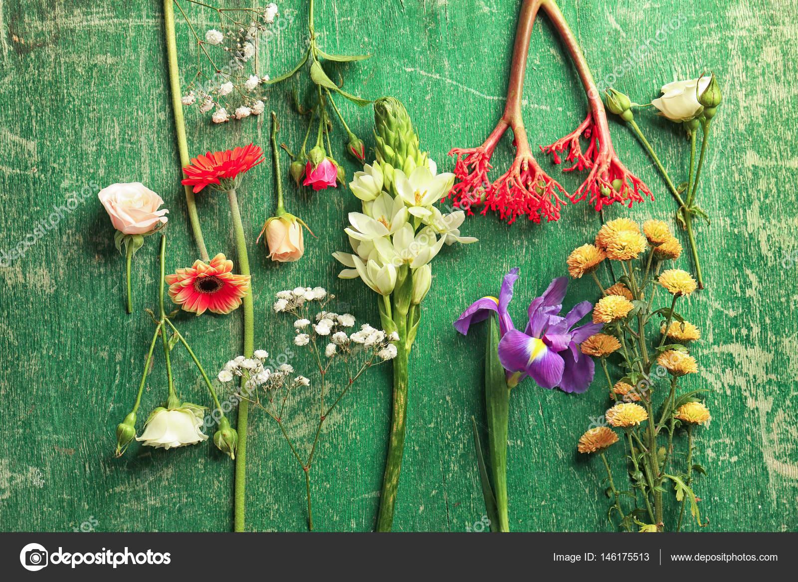 Beautiful fresh flowers stock photo belchonock 146175513 beautiful fresh flowers on green wooden background photo by belchonock izmirmasajfo Gallery