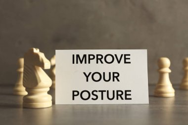 paper with phrase IMPROVE YOUR POSTURE