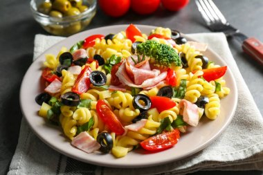 Cold pasta salad on table