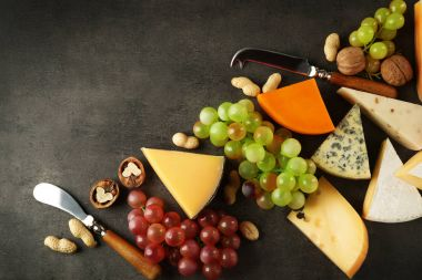 Sorts of cheese and grapes