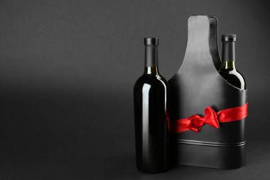 wine bottles and black gift box