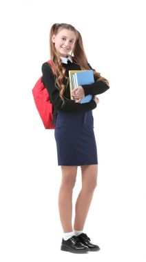 Teenage girl with backpack and books on white background
