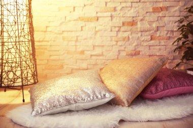 Three shiny decorative pillows