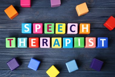 cubes with text SPEECH THERAPIST