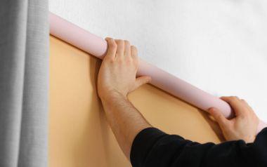 hands installing roller blinds