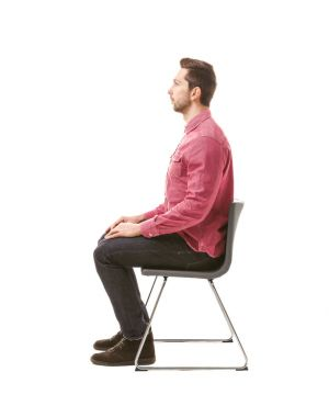 Incorrect posture concept. Man sitting on chair isolated on white