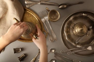vintage tableware and female hands