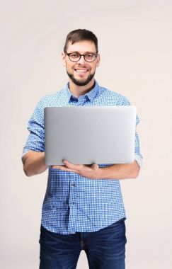 Handsome young programmer with laptop