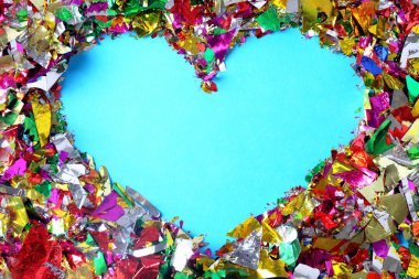Confetti with heart shape on color background