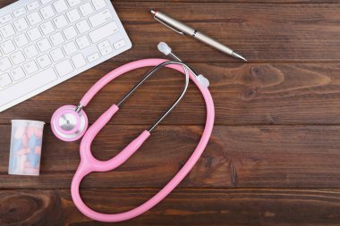 Stethoscope with keyboard and pills