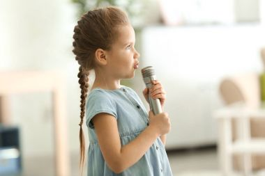 Cute little girl with microphone