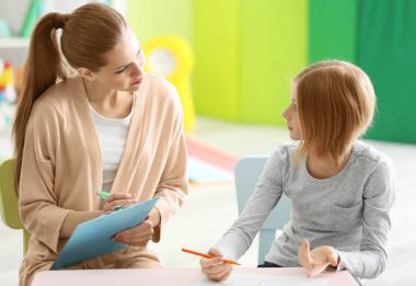 psychologist working with teenager girl