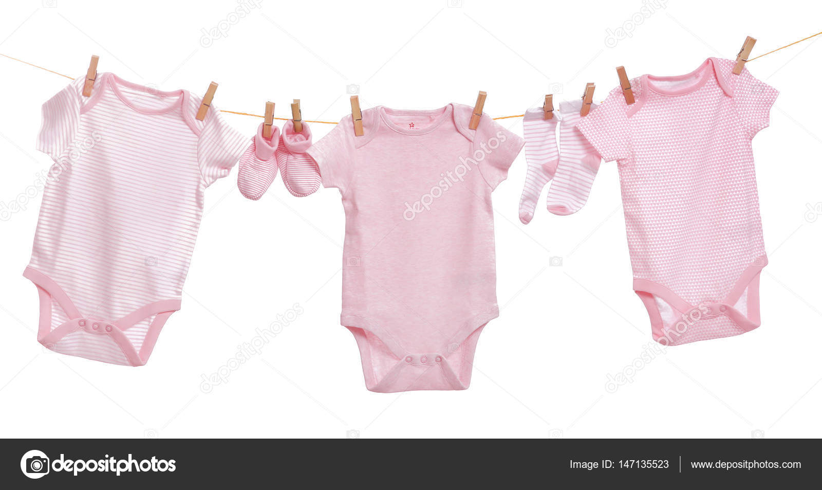 baby clothes hanging stock photo belchonock 147135523