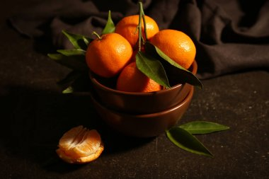 Bowl with fresh tangerines