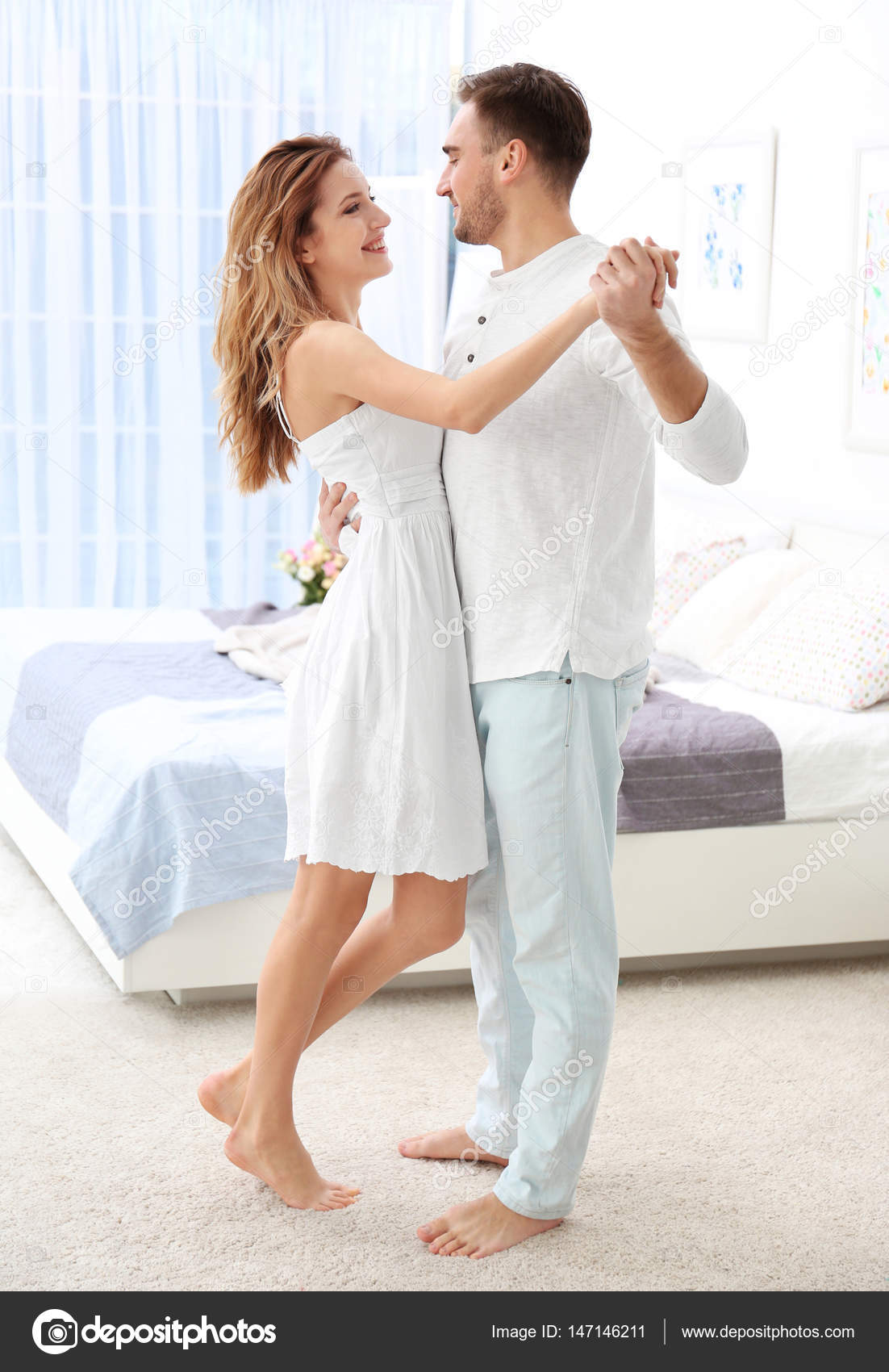 Young Couple Dancing At Home Stock Photo C Belchonock 147146211
