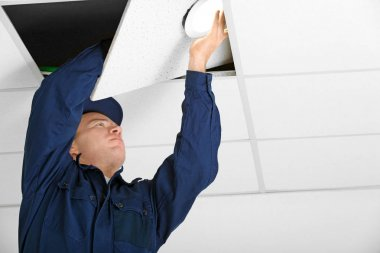 Electrician checking wiring