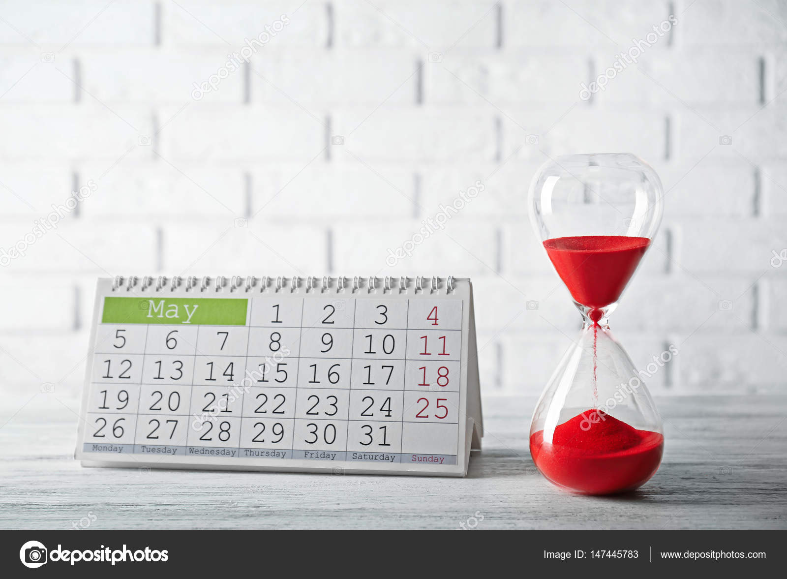 hourglass with red sand and calendar  u2014 stock photo