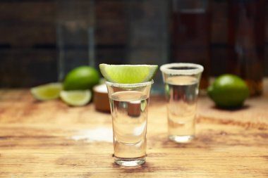Tequila shot with juicy lime