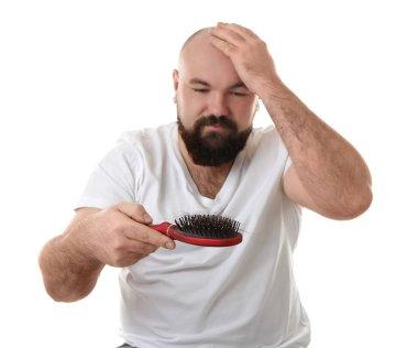 Bald man with hair brush