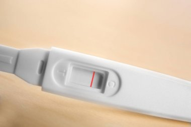 Pregnancy test on wooden table