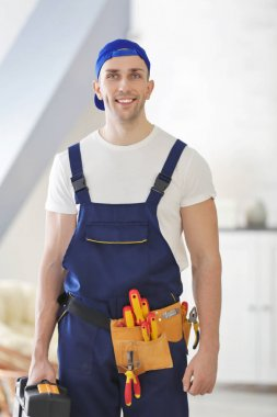 Young electrician with tools