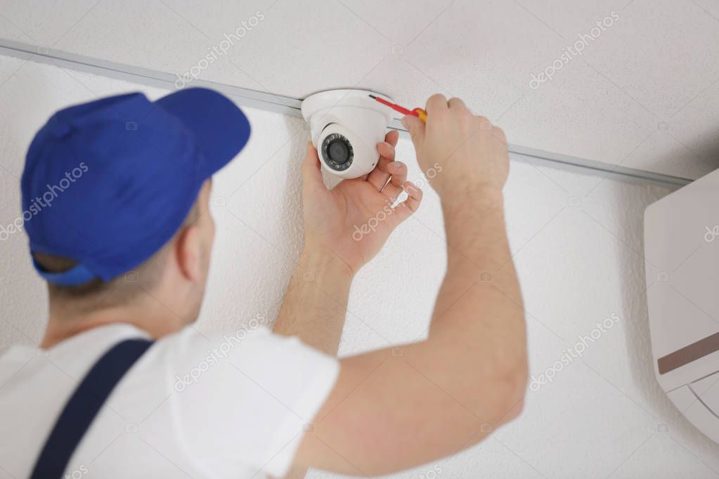 Technician fixing video camera