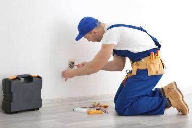 Electrician repairing socket