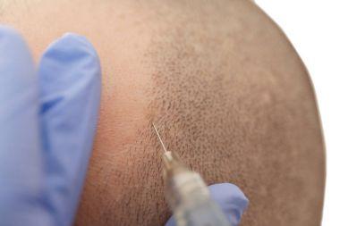 Man receiving stimulating injection